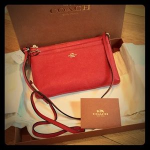 Coach Handbags - NWT Coach Leather Swingpack in Red Currant 👠