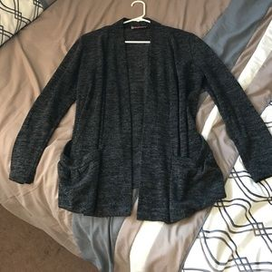 Charcoal gray sweater with two pockets in front