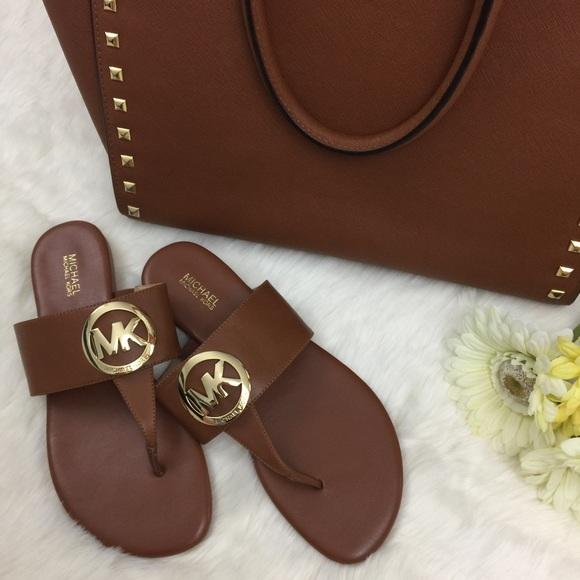 b1f466baed5f46 Michael Kors Luggage Racquel Thong Sandals. M 58d48170d14d7b8b50009d1f