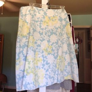 Blue skirt with yellow and white floral design