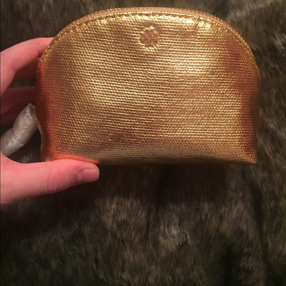 Tory Burch Handbags - NWT Tory burch cosmetic bag