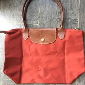 Longchamp Handbags - Red Longchamp Le Pliage medium tote