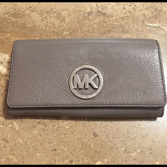 ff2efc1c5e84 Michael Kors Fulton Carryall Wallet in Putty color.  M 58d1c6604e8d179cfe004fce. Other Accessories ...