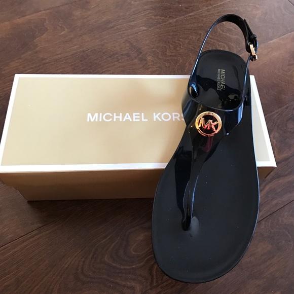 e9a444787d5a Michael kors black jelly sandals. M 58d3ddf1522b45566d06efb3