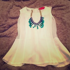 AKIRA Tops - White peplum top and blue statement necklace.