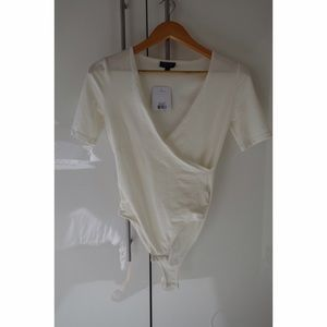Topshop Tops - NWT Cream short sleeved v neck Topshop bodysuit