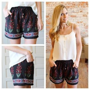 Pants - Black and red floral shorts