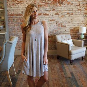 Dresses & Skirts - Gray sleeveless swing dress with pockets