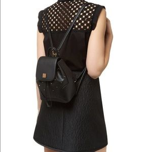 MCM Handbags - AUTHENTIC NWT MCM Claudia Studded XMini Backpack