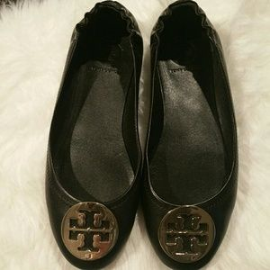 Black and gold Tory Burch flats