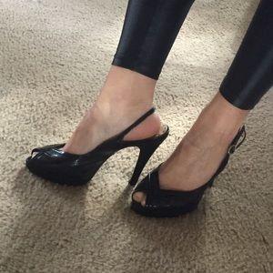 BCBGirls Shoes - BCBGirls snake print peep toe pumps!
