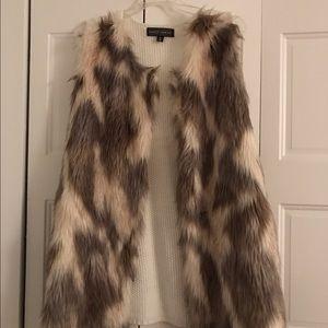 3x faux fur vest crocheted back. Worn once.