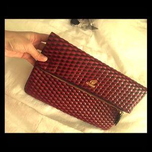 Hogan Handbags - A red patent versatile cross body /clutch