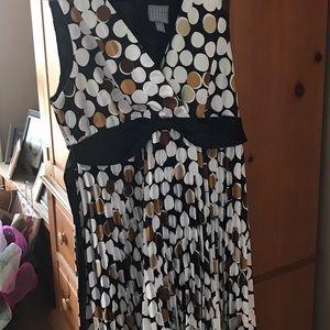 Sleeveless dress with sash & small pleats on skirt