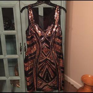 bebe Dresses & Skirts - Black and gold Bebe sequin dress