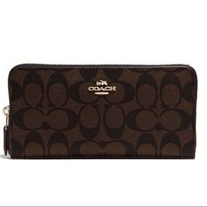 Coach Handbags - SALE ! Coach zip wallet in signature