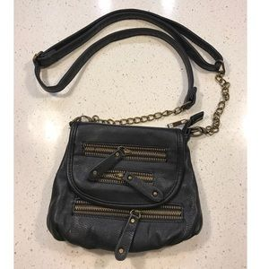 Black cross body purse with gold zippers
