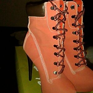 Pink laced up heel boots