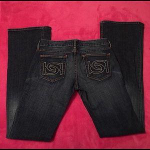 Bebe stretchy flair jeans! Sz: 29 medium to dark