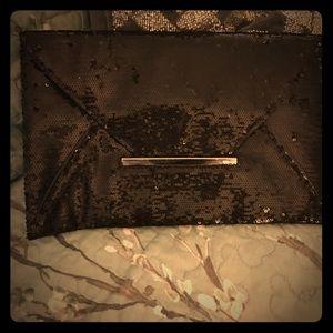 Cache Handbags - Blk sequined envelope clutch