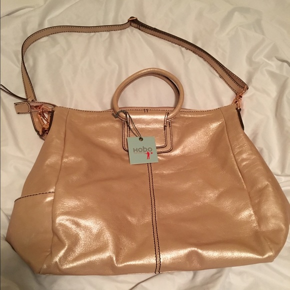 4f448f2977ff HOBO Sheila bag in metallic blush