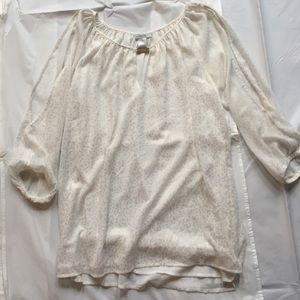 Cache Cream with gold animal print blouse