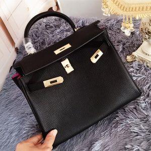 Black Kelly leather bag