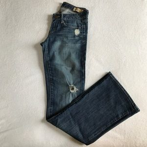 GAP limited edition distressed flare jeans.