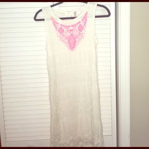 White lace dress with hot pink necklace detail
