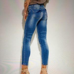 Chillin Girl Denim - Distressed medium blue mid rise jeans Size 7/9