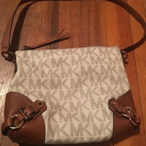 Michael Kors Handbags - Michael Kors cross shoulder bag used once