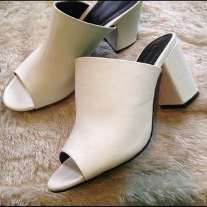 FINAL PRICE DROP!!White heeled slides mules size 7