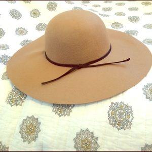 Felt tan hat with ribbon. Worn once!!