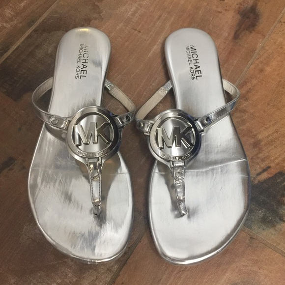 4b9c200c004f Michael Kors Silver Melodie Thong Sandal. M 58db118b2ba50a28bd02927f