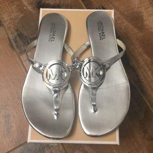 9f8e22dd444 Michael Kors Shoes - Michael Kors Silver Melodie Thong Sandal