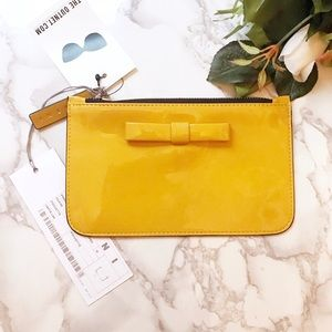a8e92e54b372 ... Auth w tag Marni yellow bow leather pouch  295 ...