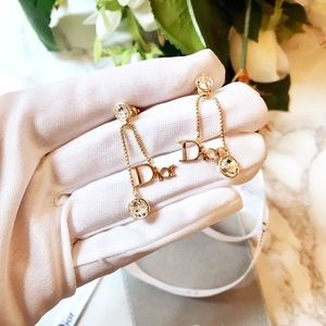 Christian Dior Jewelry - Beautiful Dior initials gold logo earring