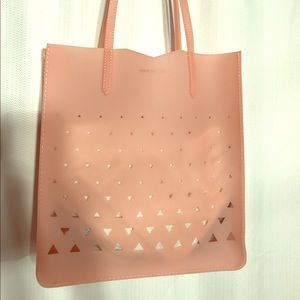 Eddie Borgo Handbags - Eddie Borgo soft rubber pink cut out bag.
