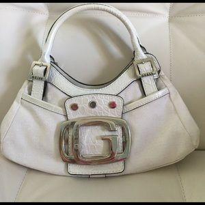 Guess Handbags - GUESS Small bag. Snap closures.