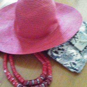 Red floppy straw hat
