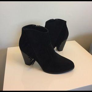 Brand new, never worn black booties