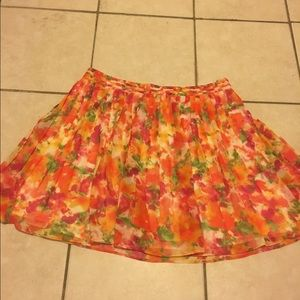 Bright floral pleated mini skirt