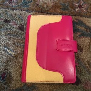 Clinique pink and yellow Organizer book