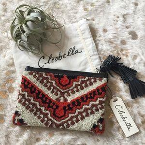 Cleobella Handbags - Cleobella Sintra Carpet Textured Tassel Clutch