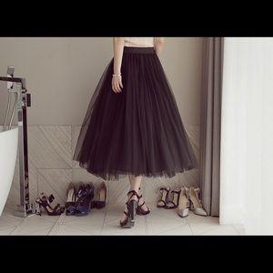 Brand new black yarn skirt