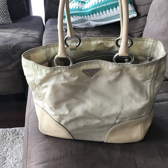 a861811d5fac Prada off-white nylon and leather purse. M 58dfae30f09282279a00544c. Other  Bags ...