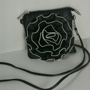 Handbags - Leather crossbody with flower detail