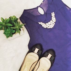 Blue collared tiered sleeveless cropped blouse