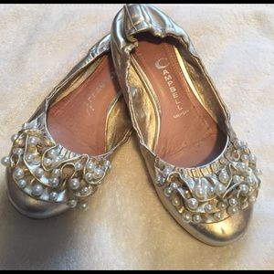 Darling pearl accented gold ballet flats