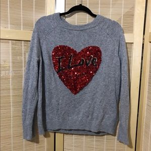 Gray sweater with a red sequins heart from h&m